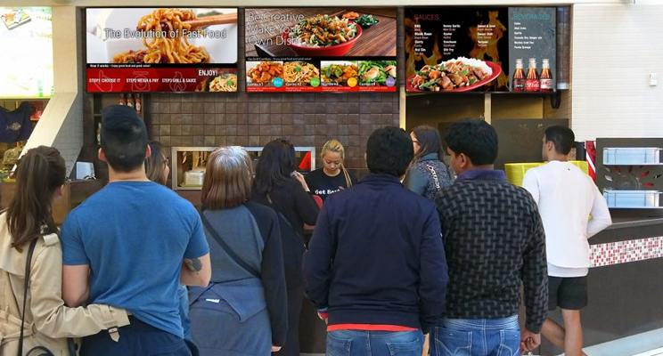 Line up for a food court stall that has digital menu boards