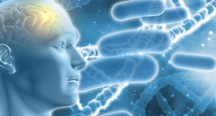 Illustrated drawing of a human face with the brain illuminated with cells and DNA in the background