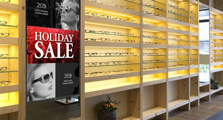 Digital signage promoting a holiday sales at an eyeglass retailer