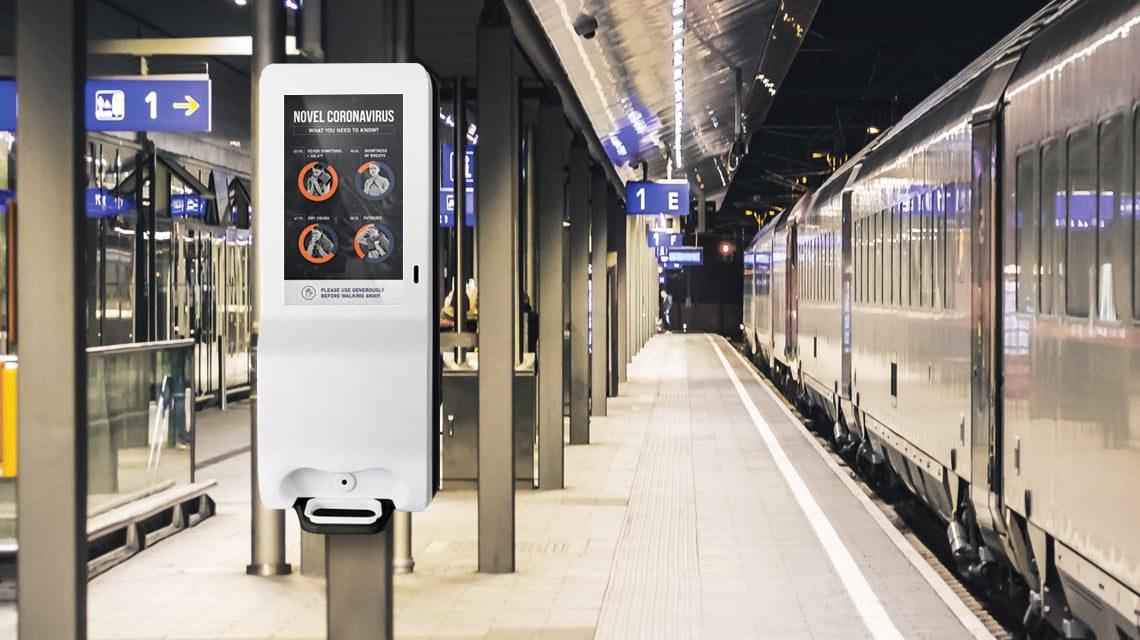 a digital signage kiosk in a skytrain station