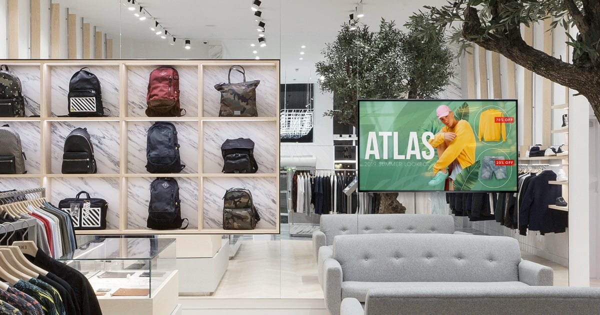 digital signage in a retail store with bags on the shelf