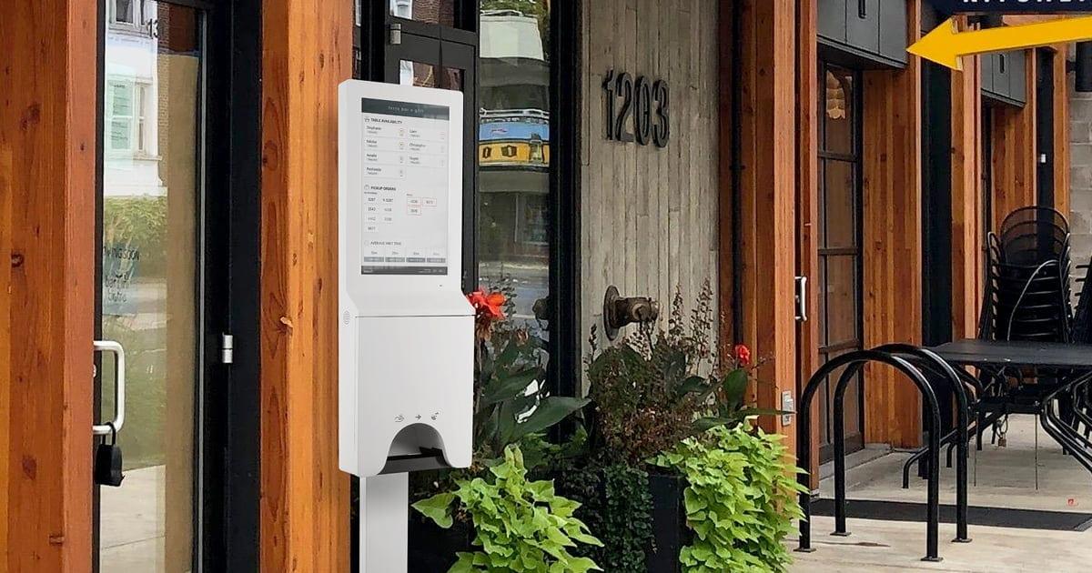 Digital signage kiosk display outside of a quick service restaurant