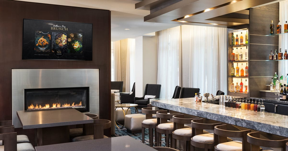 modern restaurant with firepiece and digital signage