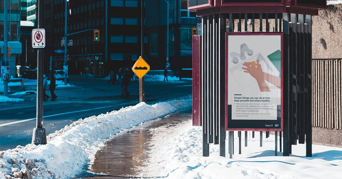 Digital signage at a bust stop with snow on the ground