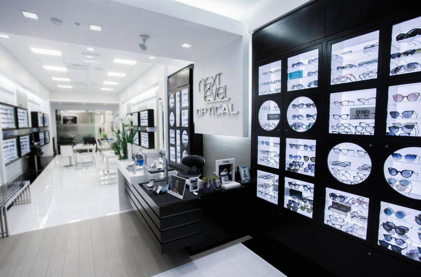 white retail shop with glasses on the wall