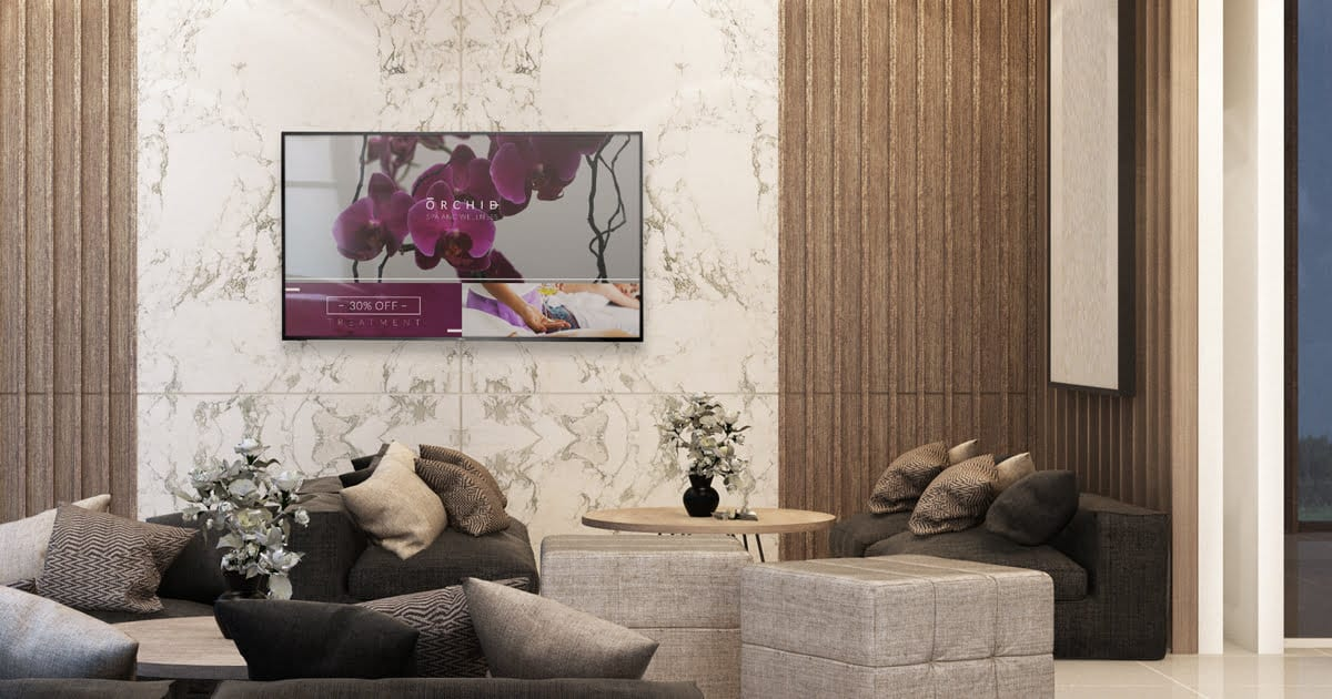 elegant hotel lobby with a centered digital screen with deals and offers
