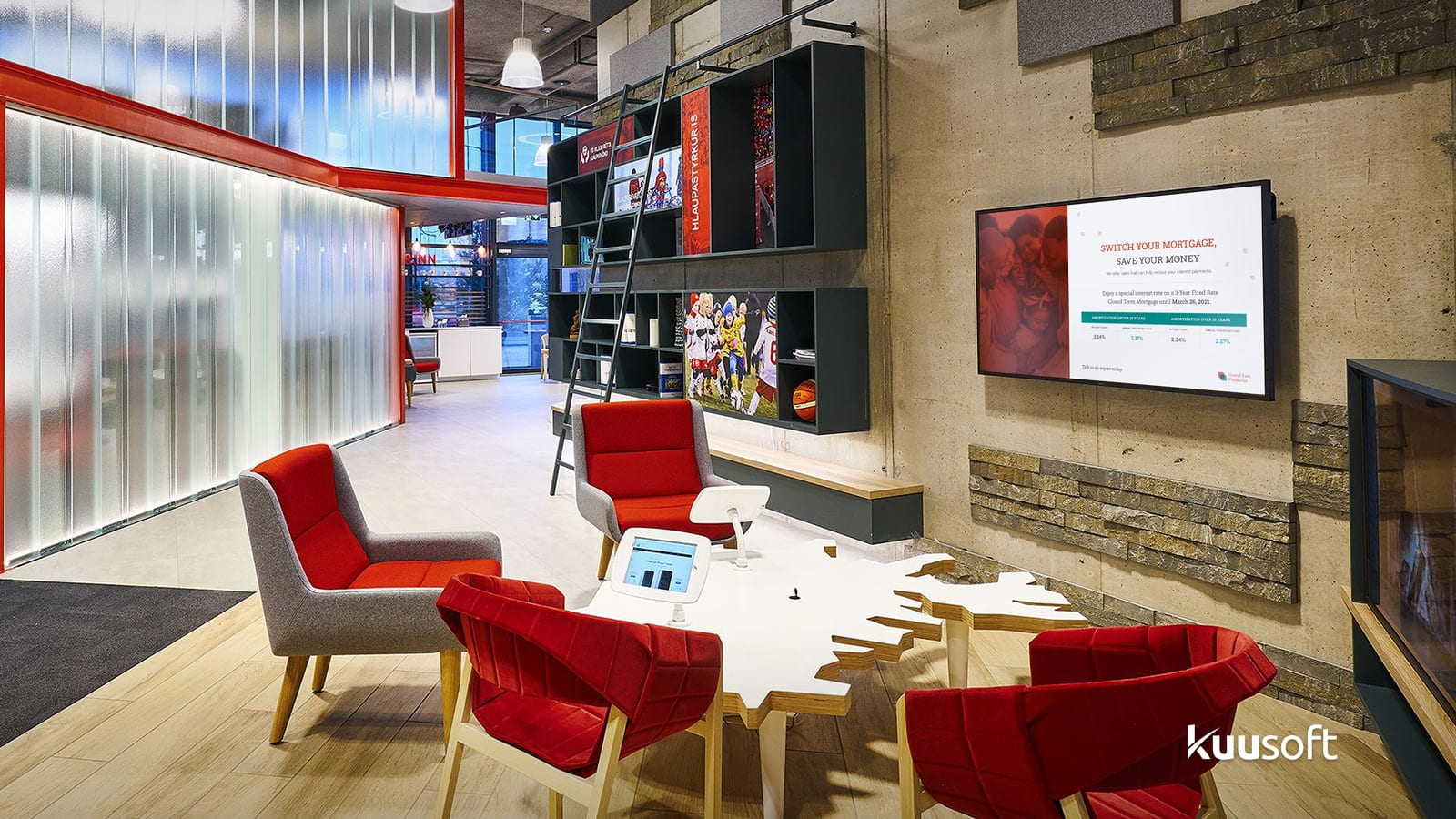 An innovative bank with comfotable chairs and digital signage in branch