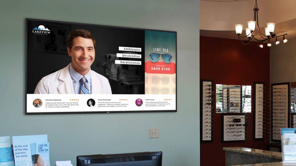 Digital signage TV display in an optometrist's reception with content on the doctor promotions and social media reviews