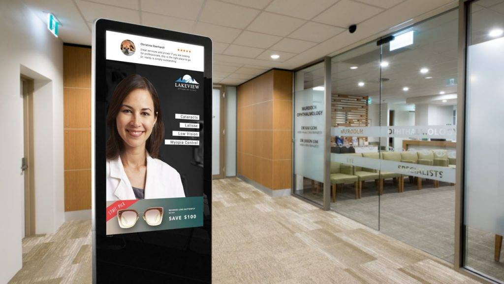 Digital signage kiosk display showing info about the Optometrist social media reviews and promotions